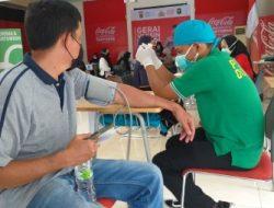Coca-Cola Europacific Partners Indonesia Bersama Polda Lampung dan APINDO Gelar Pelayanan Vaksinasi COVID-19 Bagi UMKM dan Masyarakat Umum